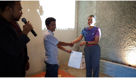 Door prize given by Mrs. Nila to Mr. Muhsin